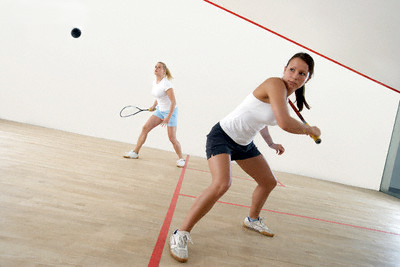ženy hrající squash